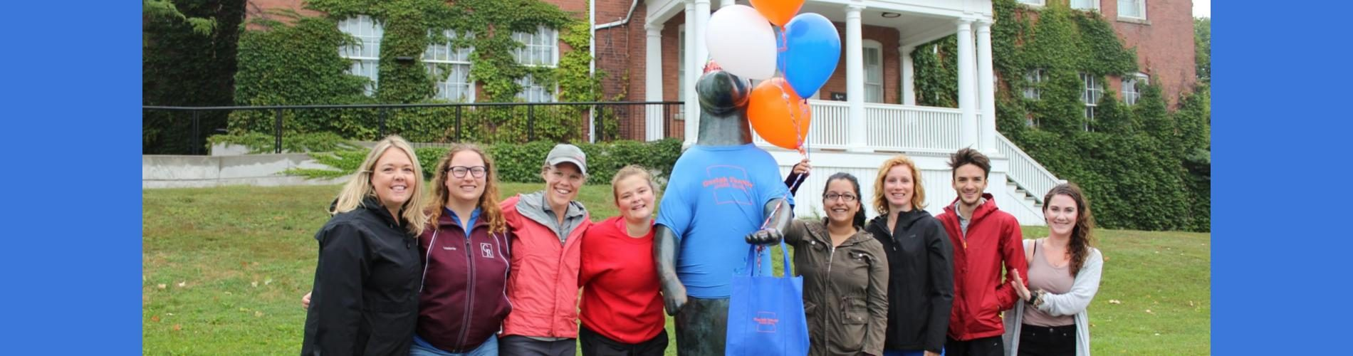 Photo of study team with decorated bear