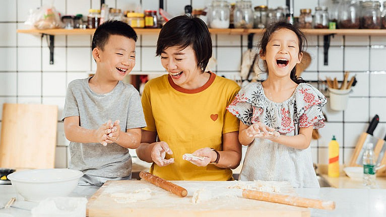 Mom and two children making bread