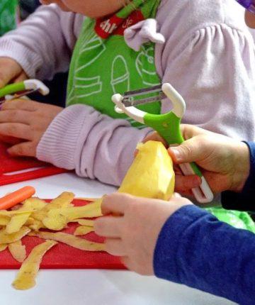 image of kids peeling potatoes